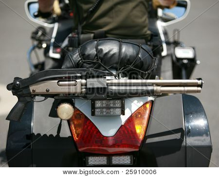 motorcycle police with shot gun attached