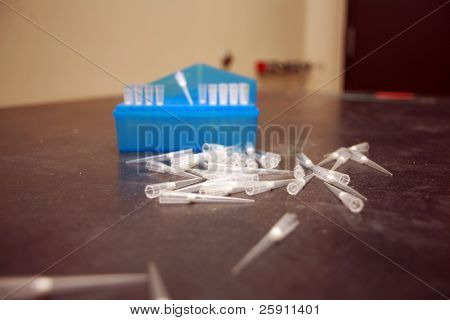 pipettes scattered on a table in a science lab