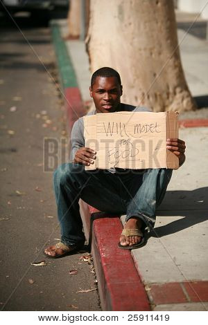 "a african american male model holds a cardboard sign that reads ""will model for food"""