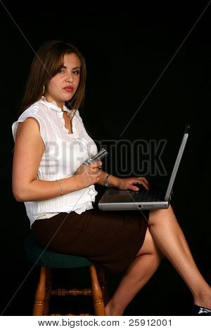 latina receptionist or secretary with a laptop computer and a antique 1887 derringer pistol for protection