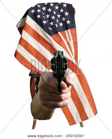 a human hand points a loaded pistol towards you the viewer while it sits infront of an american flag isolated on white