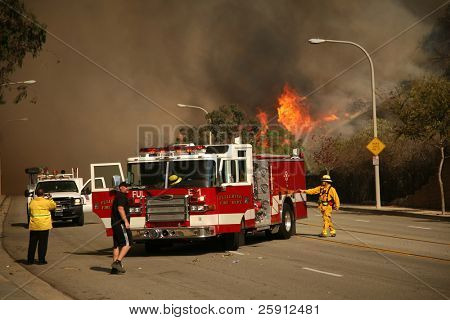BREA, CA - NOV 15: Fire Fighters and emergency personal rush to control fires in Brea CA.  Many homes in the area have been destroyed as a result of the wildfires.
