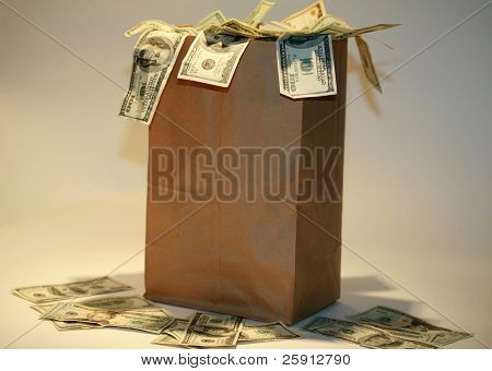 a Generic brown paper bag over flowing with Money