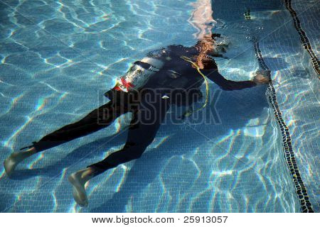 a scuba diver works on a swimming pool or practices his diving techniques you decide