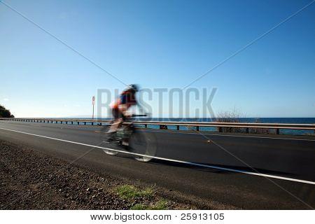 "bikers ride accross the ""Honoapi'ilani Highway"" on maui hawaii"