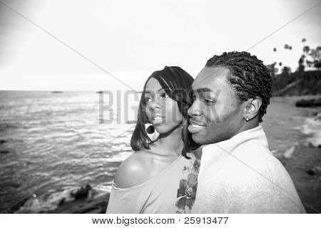 a young african american are shocked at what they see in the ocean
