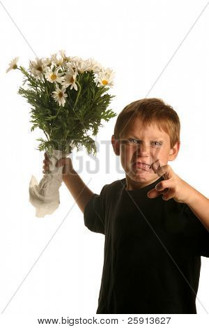 a young boy snarles as he holds a bunch of white daisies isolated on white