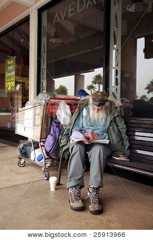 LONG BEACH, CA - MAY 28: A homeless person falls asleep on May 28, 2009 in Long beach, CA. According to a 2008 report by the Dept of Housing and Urban Dev, about 1.6 million were homeless in 2007.