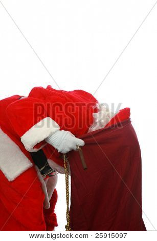Santa looking in his magic bag of presents isolated on white with room for your text