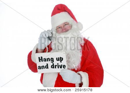 "santa claus holds a ""hang up and drive"" sign and a cell phone           isolated on white     with room for your text"