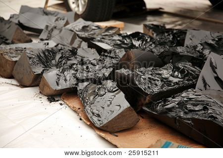 Tar ready to be melted for a roof repair job