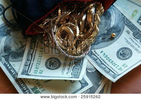 cash 4 gold Gold Jewlery lays on american money