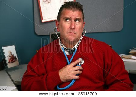 a doctor checks his own heart beat