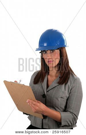 an attractive young woman contractor in a hard hat and safety glasses, isolated on white
