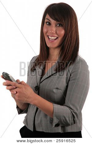 an attractive young woman reads and sends text messages from her phone, isolated on white, with room for your text