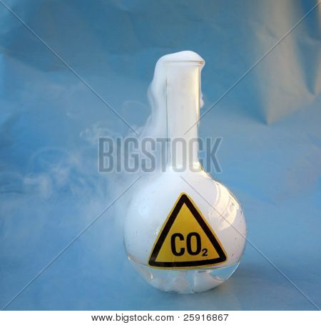 a 500ml flask filled with Carbon Dioxide aka CO2 releasing it into the atmosphere over a blue background