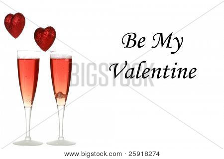 Two glasses of Pink Champagne one with a wedding ring inside and hearts in the air. isolated on white with room for your text or images