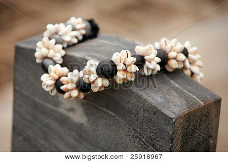 Kukui Nut Shell Lei on a grave stone