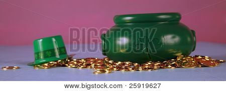 a Leprechaun's pot of gold coins on a blue and pink background