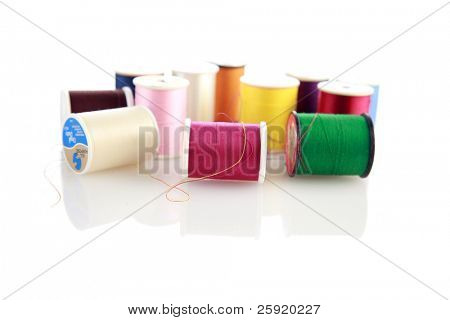 spools of thread on white with reflections for depth