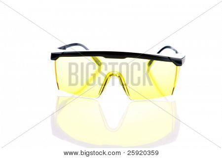Industrial yellow Safety Shooting Glasses on white with reflections
