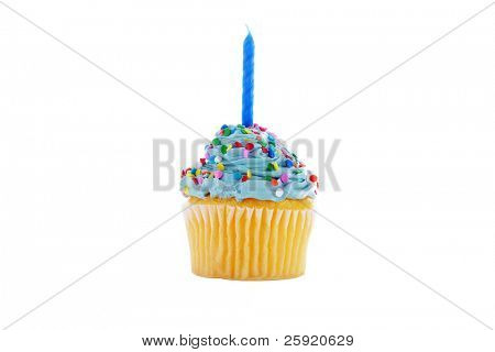 a cupcake with blue frosting, sprinkles and a candle.  isolated on white
