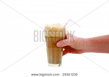 a human hand holds a root beer float isolated on white