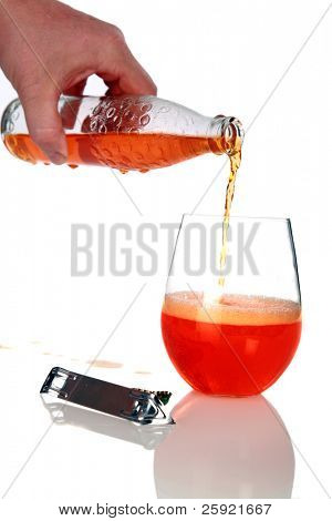 Orange Soda being poured into a glass  isolated on white with shadows