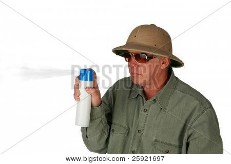 a man in a pith Helmet sprays air freshener isolated on white with room for your text or images