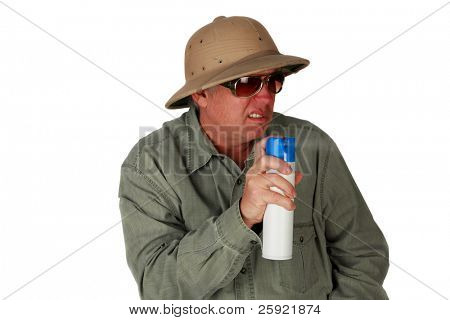 a man in a pith Helmet sprays bug spray or air freshener isolated on white with room for your text or images