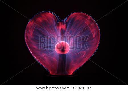 Heart shaped plasma ball isolated on black