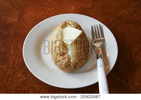 The perfect baked potato, with sour cream, chives, butter and bacon bits.  shot with various views