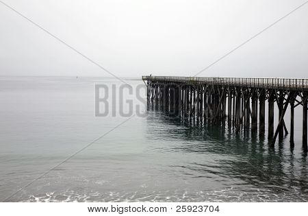 pier on the pacific coast area of Cambria, CA one early morning
