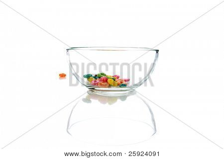 colorful childrens breakfast cereal loops with milk. isolated on white