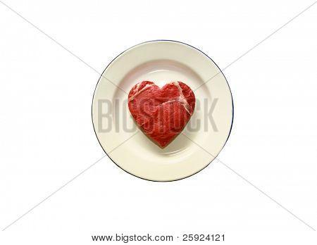 fresh raw USDA beef steak cut into a heart shaped on a plate