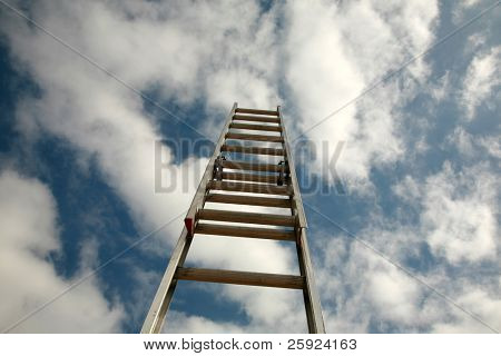 ladder to success, extention ladder extened into the blue sky with great white fluffy clouds. representing success in business, reaching for the stars or clouds, ladder of success, corporate ladder