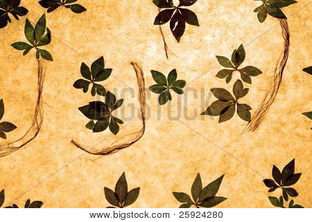Handmade rice paper infused with leaves and natural fibers of various shapes shapes and sizes