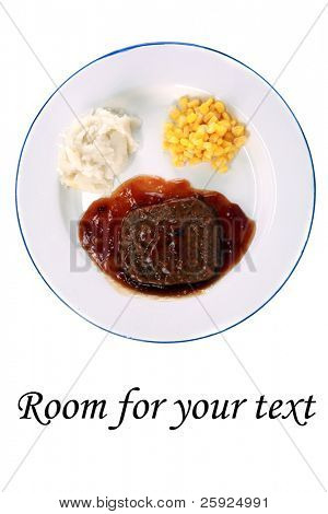 salisbury steak tv dinner with mashed potatoes and corn on a white plate, isolated on white