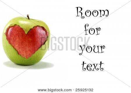 """a green """"granny smith"""" apple with a red """"red delicious"""" apple heart shape cut out and placed inside the middle of the green apple, isolated on white with room for your text"""