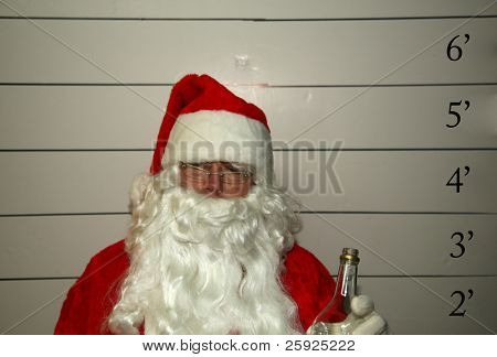 Bad Santa Santa Claus has been a bad bad boy this year and was arrested, and had his mugshot taken  Dark Christmas Humor images for all to enjoy
