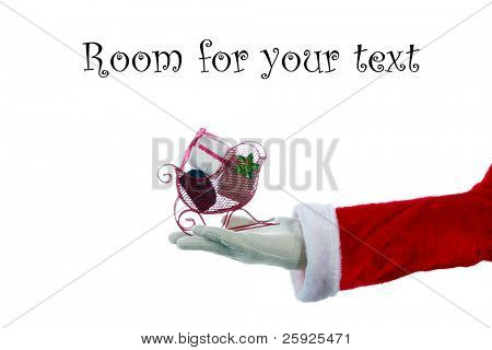 A Santa Claus arm holds a red christmas present isolated on white with room for your text or images