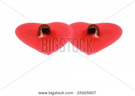 Chocolate covered Cordial cherries lay in a red heart shape of maraschino juice isolated on white with room for your valentines day text
