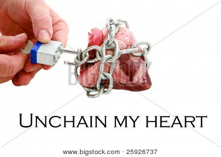 a man unlocks and unchains his heart. isolated on white with room for your text