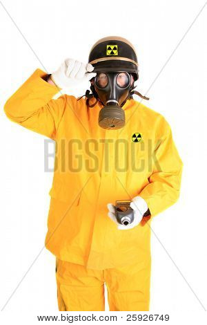 """A Nuclear Safety Inspector wears his """"Anti-Radiation"""" suit, gas mask, police helmet and holds his Geiger Counter while isolated on white with room for your text"""