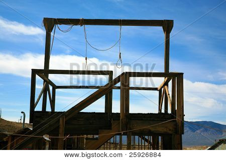 a gallows in a real ghost town in nevada usa with two nooses bringing to light the reality of Swift Justice from the Wild Wild West