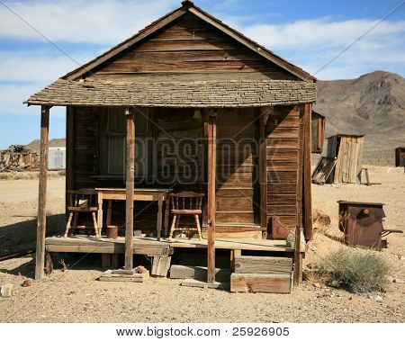an old gold miners shack in a real ghost town from the 1800's in the wild west of california or nevada