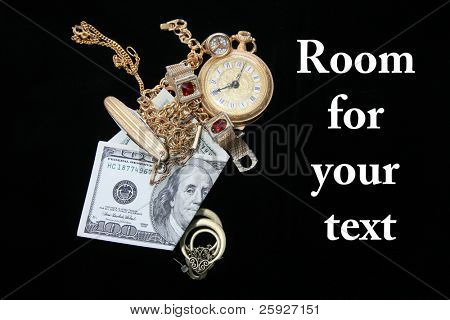 cash for gold and jewelry, isolated on black velvet with room for your text. text is easily removed and replaced with your own