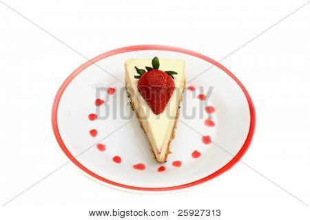 strawberry cheesecake on a white plate with a red rim and strawberry sauce dots in a circle