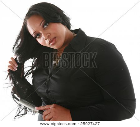 a beautiful african american woman trims her hair with a pair of scissors. isolated on white with room for your text