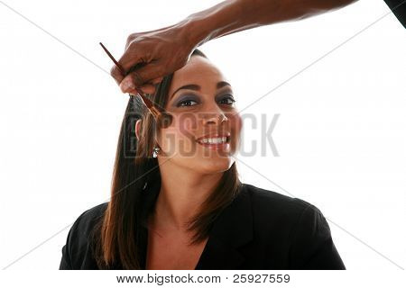 A beautiful african american woman has makeup applied by an unseen professional makeup artist in anticipation of her upcomming beauty and fashion photo shoot. isolated on white with room for your text